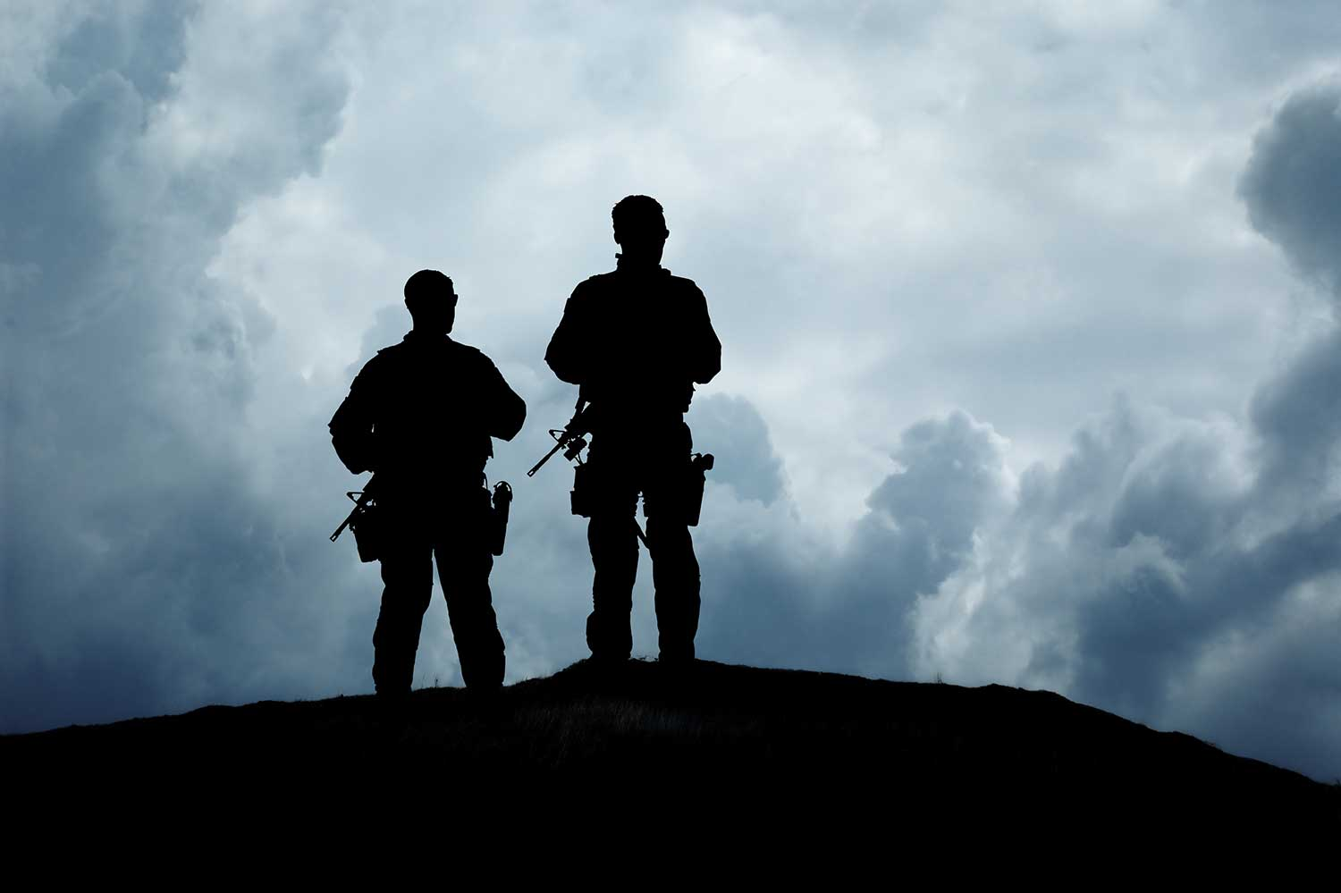 Two soldiers looking into the distance